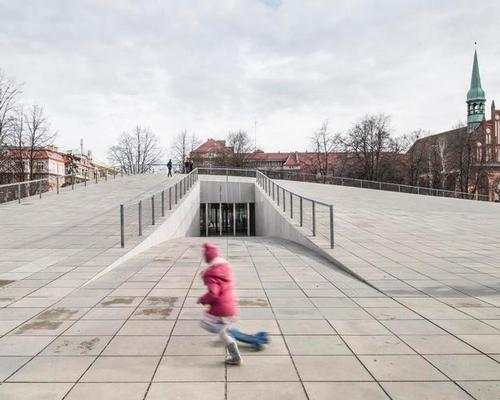 The National Museum and Dialogue Centre Przelomy is largely located underground, with its roof forming a new public space / KWK Promes