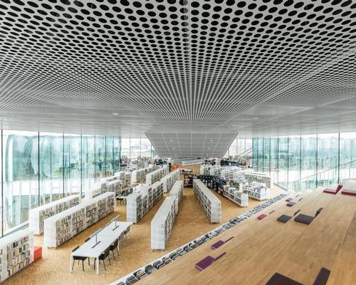The main public space of the library is its lifted panoramic reading room, which has been designed to maximise views of the cityscape / Delfino Sisto Legnani and Marco Cappelletti, courtesy of OMA
