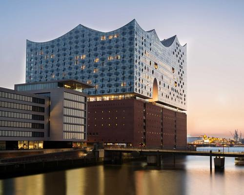The Hamburg Elbphilharmonie concert hall is a shimmering, glass-covered building designed by Swiss architecture studio Herzog & de Meuron
