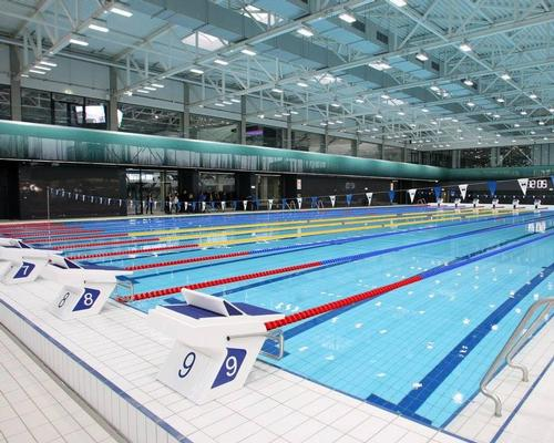 The completed centre features two full course swimming pools, a diving pool and a short course training pool / FINA
