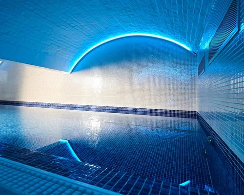 The urban retreat features an indoor pool with low-level lighting and an accompanying hydrotherapy pool / Bristol Harbour Hotel & Spa