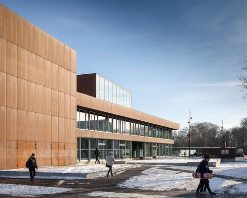 A rust-red steel facade runs around the building / Adam Mørk