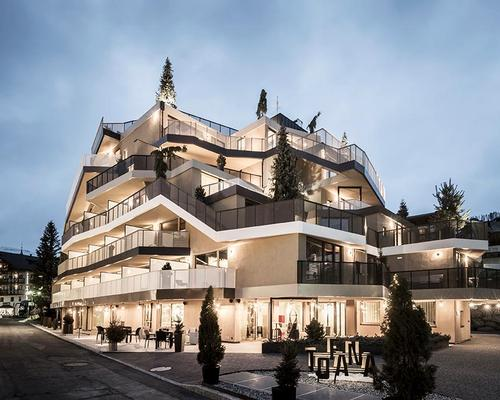 The irregular, asymmetrical silhouette of the Hotel Tofana is designed to evoke a tree-lined mountain peak / noa*