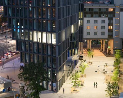 A slope of cascading patios offer social outdoor spaces / Ossip van Duivenbode