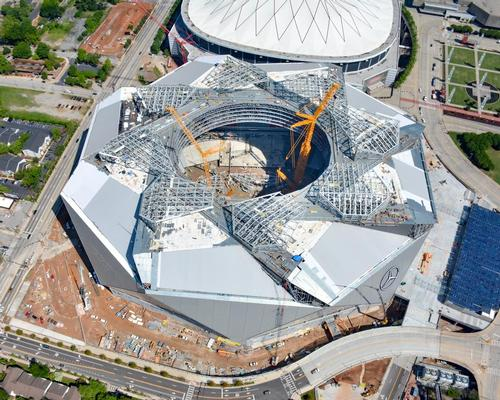 Construction workers are adding the finishing touches to the structure's unique eight-petal plastic polymer retractable roof / Atlanta Falcons