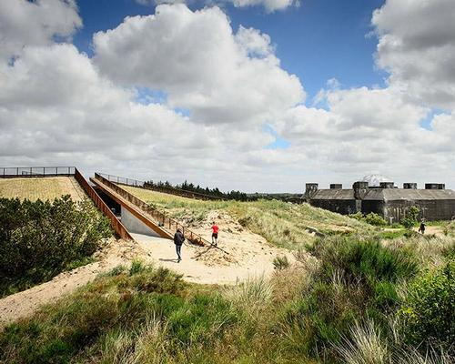 Beyond the bunker, the new museum emerges as a series of intersecting, precise cuts in the shoreland landscape / Mike Bink