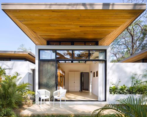 Overlapping timber roofs, made of recycled Teak planks, project out over each pavilion providing shade and creating uneven patterns / Studio Saxe