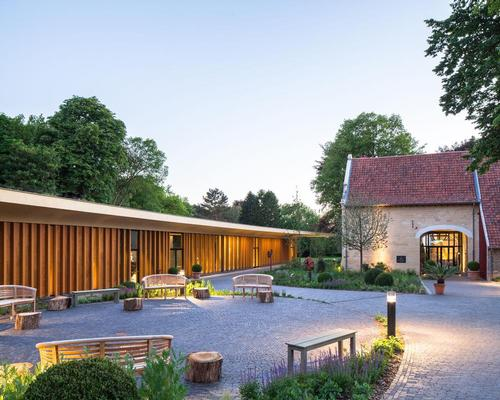 An intimate 'village square' has also been created between the pavilion and the manor farm that forms an outdoor extension of the foyer / Mecanoo architecten