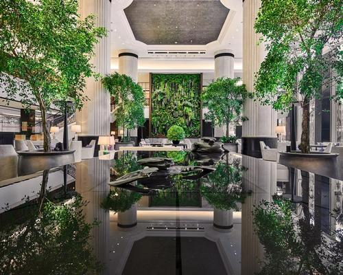 The hotel lobby has been re-designed to resemble an indoor garden featuring a living wall of live plants, symbolising a mountain / Shangri-La