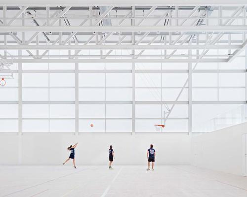 Spanish architect Alberto Campo Baeza has completed a minimalist semi-transparent sports hall for a university in Madrid