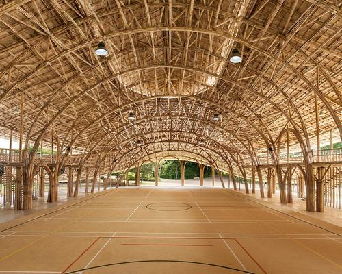 Thai studio create bold bamboo sports hall for Chiang Mai school