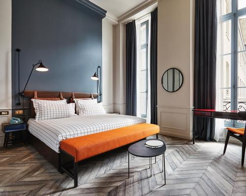 The historical grandeur is echoed in the bedrooms through cornicing, panelling and reclaimed oak chevron timber flooring / The Hoxton, Paris