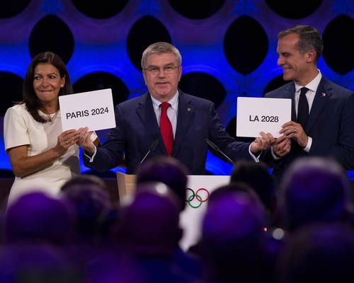 IOC president Thomas Bach (centre) announced the decision at the IOC's annual meeting held in Lima, Peru