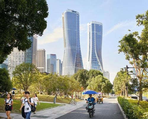 The Raffles City development has been conceived as a lively vertical neighbourhood and transit hub for the Qianjiang New Town district / Hufton + Crow