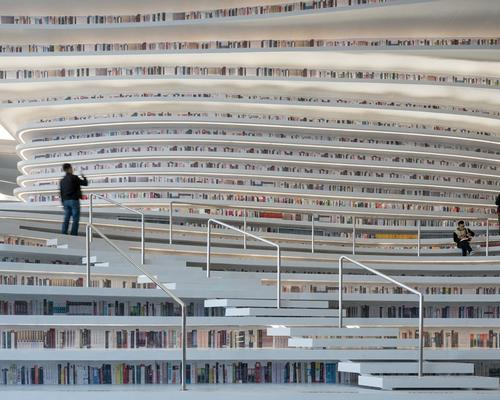The five level building holds 1.2 million books, which can be taken to a multitude of reading rooms, lounges and educational space / Ossip van Duivenbode