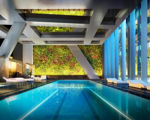 A 17,000sq ft (1,500sq m) Wellness Center will feature two large vertical gardens, designed by French botanist Patrick Blanc, framing a 65ft swimming pool / Hayes Davidson