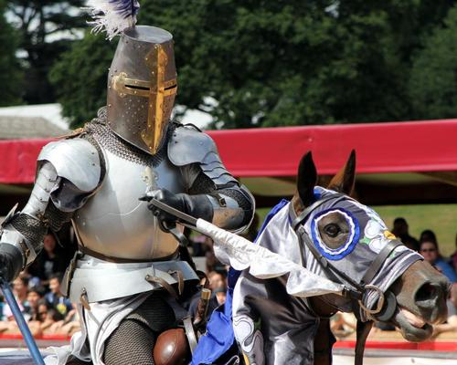 Jousting and medieval re-enactment at Warwick Castle, one of the region's top attractions / Gary Perkin / Shutterstock