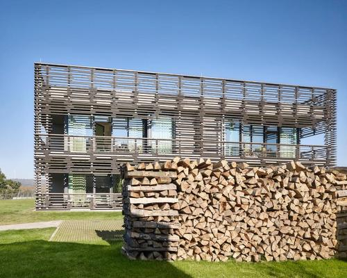 Local timber was used for the building's distinctive charred facade / Michael Moser