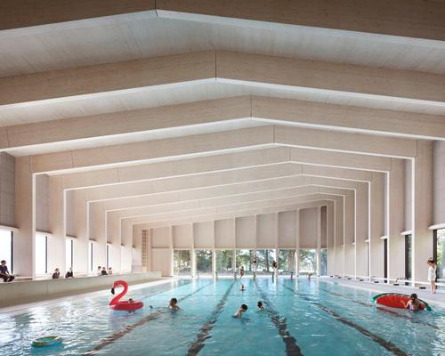 Hawkins/Brown complete timber pool facility for 'swimming among the trees'