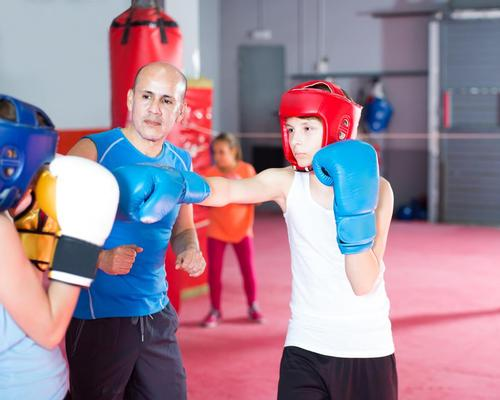 Sports volunteers experience the dual benefit of social impact and personal fitness / Shutterstock