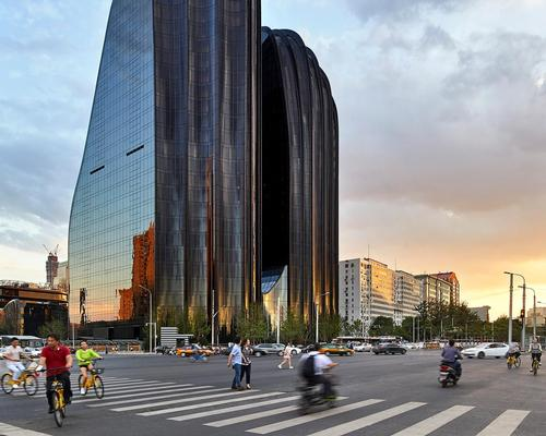 The 220,000sq m (2.3 million sq ft) Chaoyang Park Plaza is formed of ten organically-shaped buildings, each shaped by smooth curved surfaces of black and white / Hufton + Crow