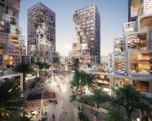 The towers are organised around a central plaza designed by Bjarke Ingels Group / MVRDV