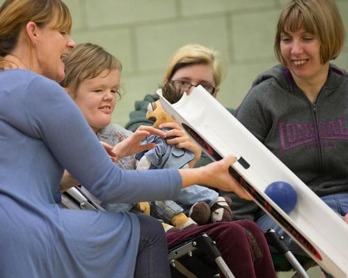 Therapists and sports coaches use Boccia to reach people with learning disabilities