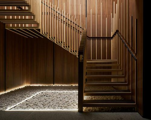 A lightweight floating timber staircase is the centrepiece of the space
