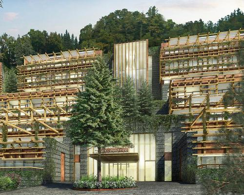 The Waldhotel is located in a forested area of natural beauty and designed to be gradually enveloped by the surrounding greenery to embrace the concept of forest bathing