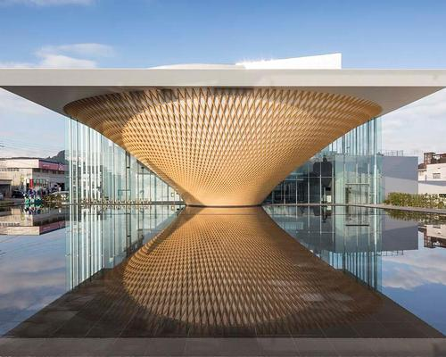 The shape of a volcano is formed in the large reflecting pool situated at the front of the complex