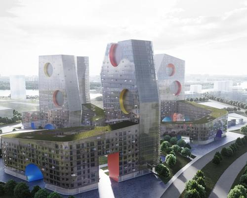 Large circular openings in the towers' facades give a defining geometric character and will be filled with the health and social spaces / Steven Holl Architects