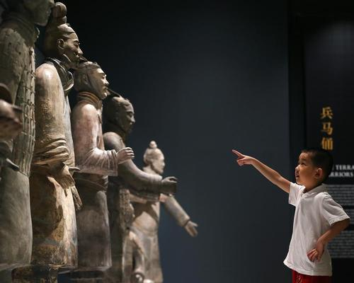 lan Ma, aged five, from Liverpool's Chinese community, is among the first to see the warriors at World Museum