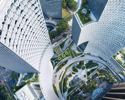 The design is conceived as 'a process of subtraction,' with smooth circular spaces carved from the building's mass / Iwan Baan