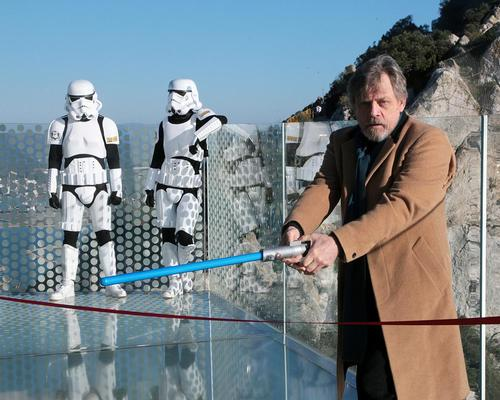 """Cutting the ceremonial red ribbon with a lightsaber, Hamil declared that the """"Force is strong"""" with the Skywalk"""
