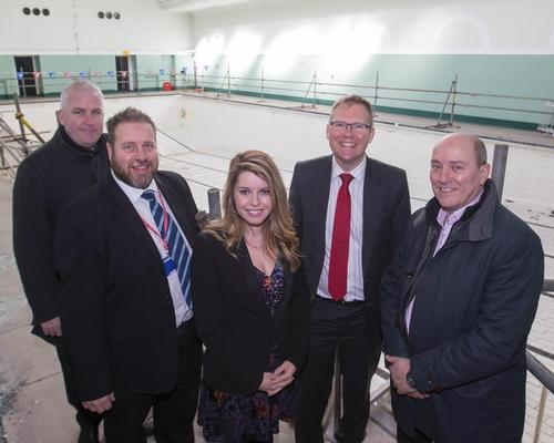 Createability's Ian Cotgrave, Fusion Lifestyle's Anthony Cawley, Cllr Nick Forbes, Cllr Kim McGuinness, and Stuart Turnbull from Newcastle City Council pose in Newcastle City Pool