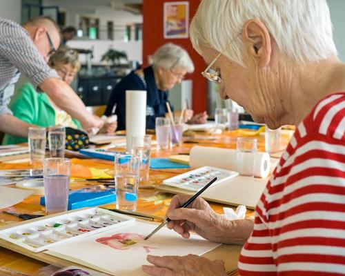 Meaningful engagement in later life through social and/or creative activities can contribute to a person's wellbeing / Shutterstock