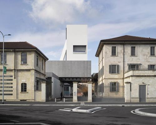 Torre is a nine-level, 60m (197ft) high tower with a facade that alternates between glass and white concrete surfaces / Bas Princen, Courtesy Fondazione Prada