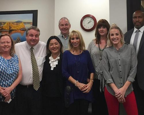 Executives from NFP and EMI Health along with Arizona Spa & Wellness Association president Mia Mackman, third from left