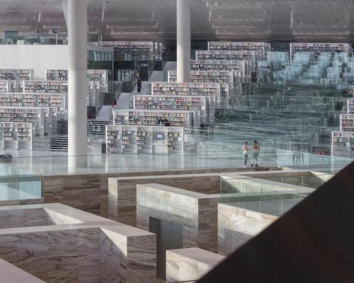 Conceived as a space for reading, socialising and browsing, the building houses more than a million books and space for thousands of readers over an area of 42,000sq m (452,000sq ft) / Delfino Sisto Legnani and Marco Cappelletti, courtesy of OMA