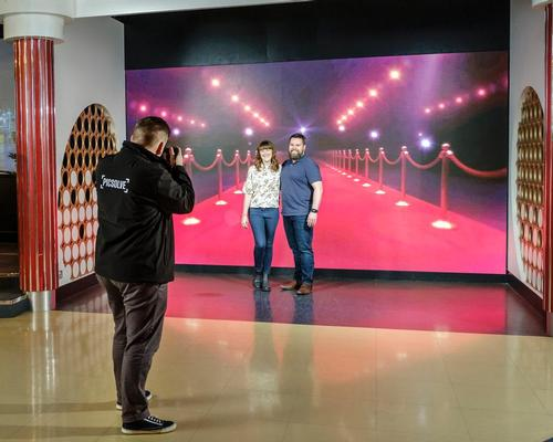 The Experience Wall is a collection of floor-to-ceiling HD screens, replacing the traditional green screen