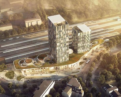 Hamburg-Altona station will house a rooftop green space and two towers on that roofscape, as well as cafes, restaurants, shops, fitness facilities, bicycle parking, waiting areas and entrance lobbies at its base
