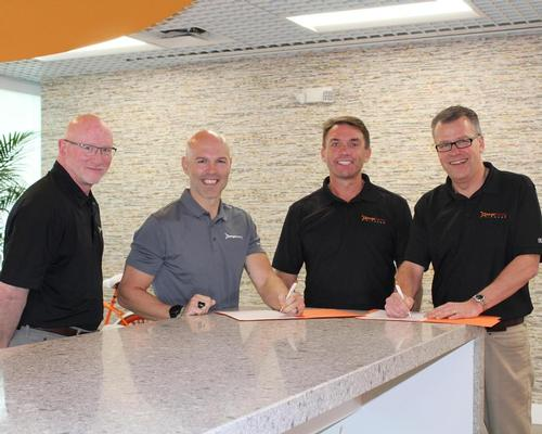 Dave Carney, president Orangetheory (left), with Orangetheory CEO Dave Long (second left) with Mike Dixon, chair of Wellcomm Health & Fitness (second right) and Alistair Firth, CEO of Wellcomm Health & Fitness (right)