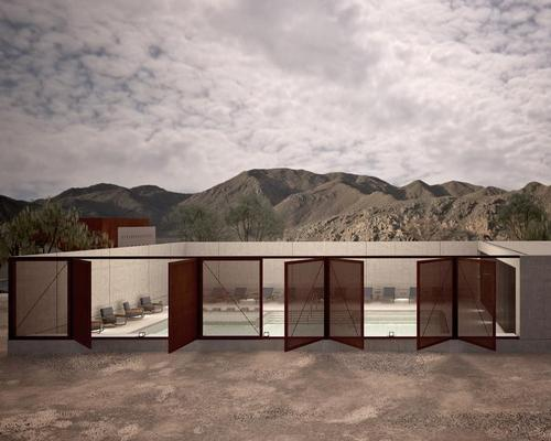 The saltwater pool is flanked by three walls, the fourth being Corten butterfly doors that completely open up to unveil the landscape of Mleiha as a backdrop