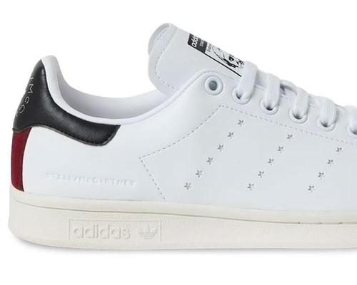 The shoe replaces Adidas's trademark three stripe motif with a star pattern