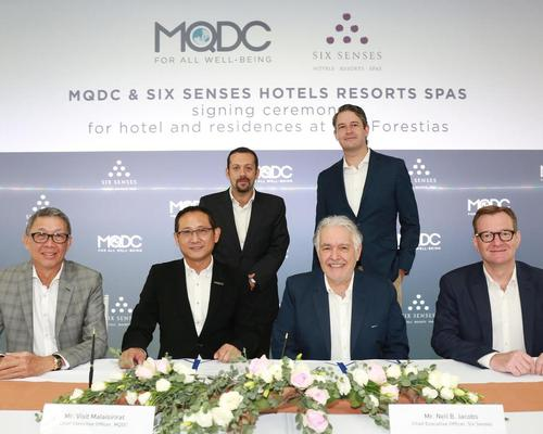 Representatives from MQDC and Six Senses at a signing ceremony at the Research & Innovation for Sustainability Center / Six Senses
