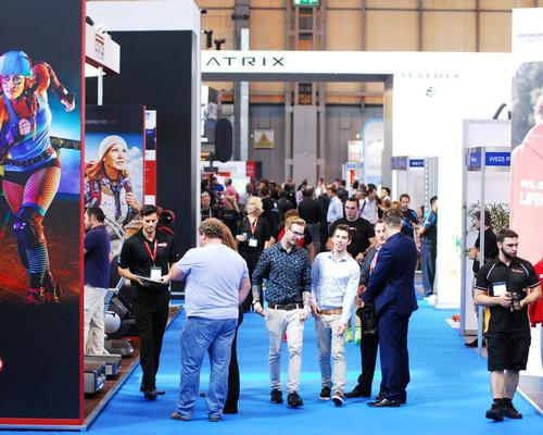 Industry delegates walk around LIW at Birmingham's NEC arena
