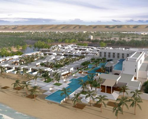 The design features low-lying, white-clad buildings flanked by a turreted fortress-style entrance / Anantara