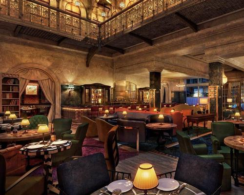 Martin Brudnizki's design echoes 19th century stylings with rich, jewel-toned furnishings and a theatrical bar area / Thompson Hotels