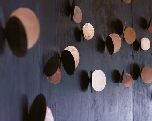 Metal sculptures on the walls resemble swarms of butterflies / Belmond Eagle Island Lodge Botswana