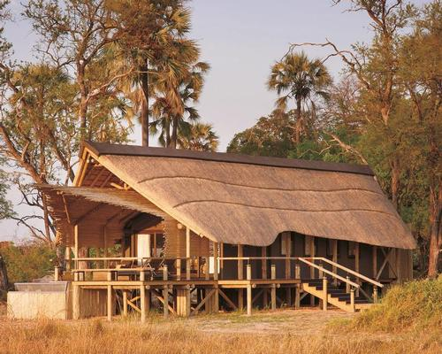 Reclaimed timber was used where possible in the creation of the structures and roof coverings are of local thatch / Belmond Eagle Island Lodge Botswana